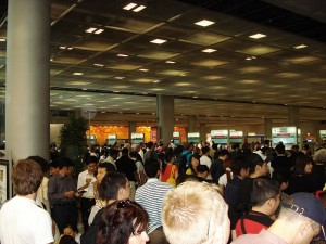 Is that a line or a mob? BKK Airport. is crazy, no matter what time of year it is.