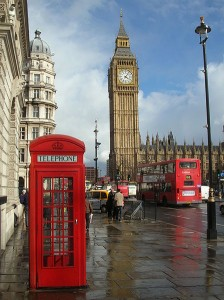 Classic red telephone box and London double-decker bus in front of the Houses of Parliament clocktower. (Photo via Wikimedia Commons)