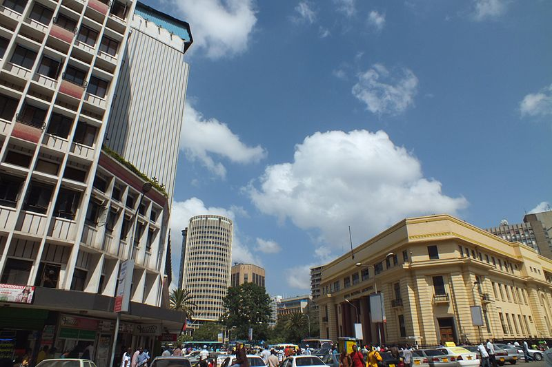 Downtown Nairobi is more skyscraper than Safari. Here we see the National Archives to the right, and the Hilton right in the center, viewed from Tom Mboya Street. Photo via Wikimedia, by Orrling.