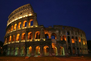 Colosseum at night in Rome, Italy. Photo via Wikimedia, by Aaron Logan (http://www.aaronlogan.com/)