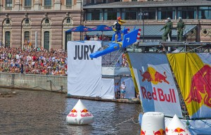 A Red Bull Flugtag flying machine makes its decent into water. Photo via Wikimedia, by Bengt Nyman.