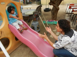 A volunteer with ProWorld in Oaxaca plays with an orphan at Casa Hogar Hijos de la Luna de Oaxaca. Photo via Katie Boyer.