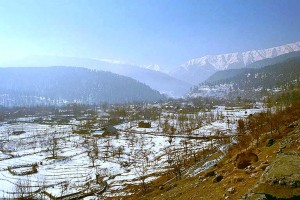 The Vale of Kashmir, from Talmarg. Kashmir, India. Via Wikimedia by Michael Petersen.