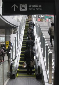 An escalator in Umeda, Osaka, Japan. Photo via Wikimedia by Kyoww.