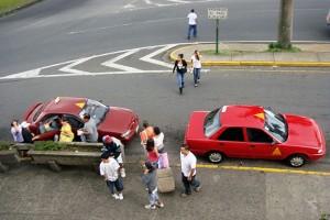 Taxi cabs in San Jose, Costa Rica. Via Wikimedia by Mariordo.